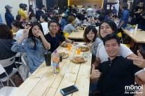 student-enjoying-pizza-dining-hall-monol