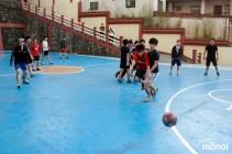 students-chasing-ball