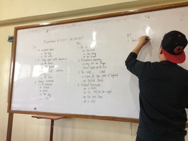 teacher-writing-board